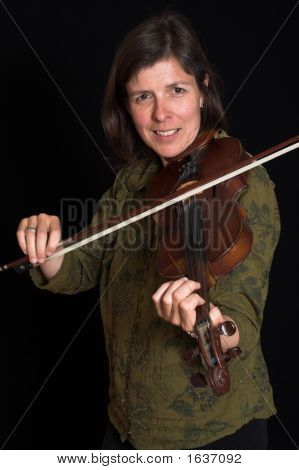 Mid-Age Woman Playing Violon Over Black