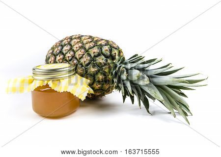 Whole Fresh Pineapple And Jar Of Pineapple Jam Isolated On A White Background