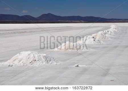 Hills of salt - salt extraction area at the world's biggest salt plain Salar de Uyuni Bolivia