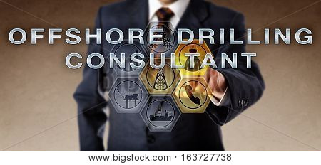 Male corporate manager or recruitment agent activating OFFSHORE DRILLING CONSULTANT on an interactive computer control monitor. Oil and gas industry metaphor for a supervisor of a drilling platform.