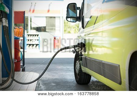Fill the machine with fuel or car refueling at petrol station.