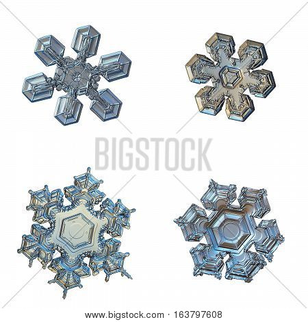 Set with four snowflakes isolated on white background. This is macro photos of real snow crystals with simple shapes, but complex and unique inner patterns.