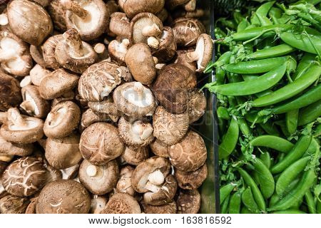 Raw mushroom and green pea in supermarket a healthy diet useful for food and vegetable concept