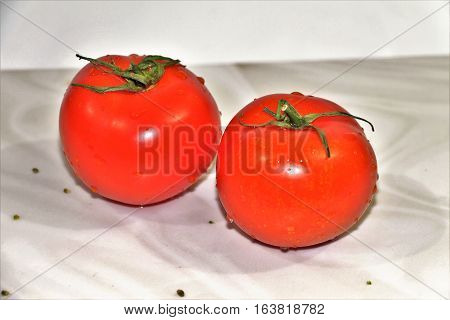 Tomatoes. Bright, red, juicy tomatoes needed for health. They should be included in the human diet. Tomato obtained very tasty salads.