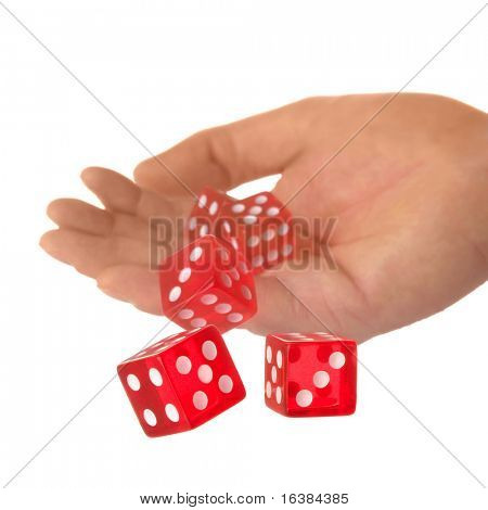 Five red dice being thrown from a hand, shallow DOF.