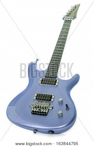 Classic blue electric guitar isolated against white background. Expensive looking modern guitar with metallic paint finish. Luxury item.