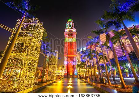 Hong Kong, China - December 5, 2016: scenic light show at Clock Tower, Tsim Sha Tsui. The landmark 44 meter tower is the only remnant of the original Kowloon Station on the Kowloon-Canton Railway.