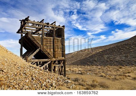 Old wooden mine workings in the Nevada desert. Head frames and bins were used to raise and sift materials.
