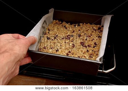 Putting Fruit Flapjack Mix Into The Oven