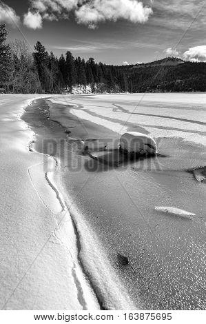 A B&W of frozen Spirit Lake shore line during winter in Spirit Lake Idaho.