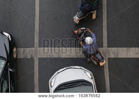 Car And Motorcycle At Intersection With Traffic Light