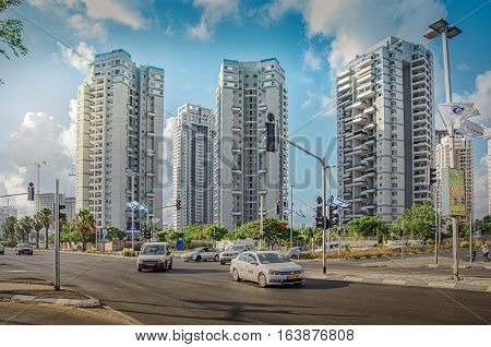 Bat Yam, Israel-May 27, 2016: View on multi-story residential buildings at intersection of HaKomemiyut and HaNeviim streets in the area of Begin City Garden