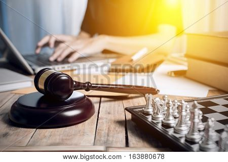 Vintage With Sunlight Effect Of Close Up Gravel Wooden On Business Lawyer Desk With Chess, Law Book,