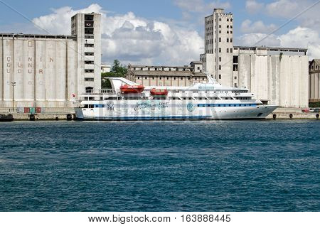ISTANBUL TURKEY - JUNE 8 2016: The aid ship MV Mavi Marmara docked at Haydarpasa on the Asian side of the Bosphorus in Istanbul Turkey. The IHH charity-run ship was controversially boarded by Israeli forces while attempting to break the blockade of Gaza.