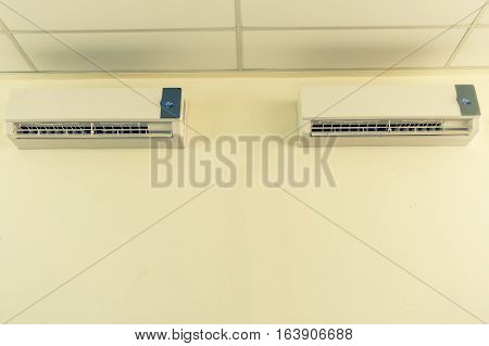 Air conditioner split type embed on wall of living room. Twin air conditioning.