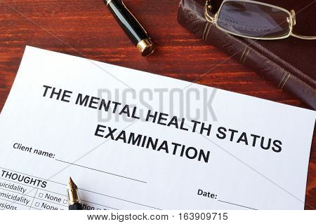 The mental health status examination (MSE) form on a surface.