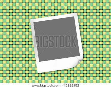instant photo frame on fabric background
