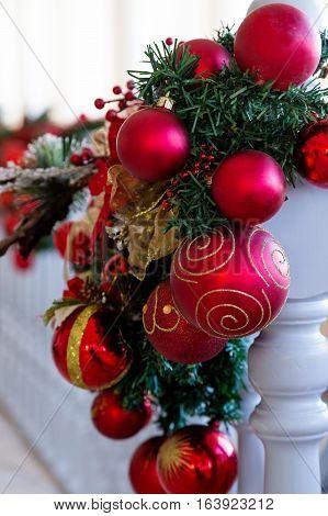 Christmas Balls Decoration On White Railing
