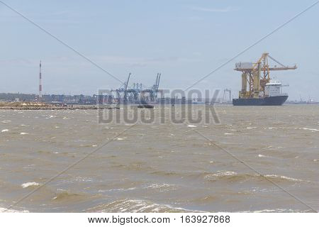 Heavy Load Carrier Ship With Rio Grande Port In Background