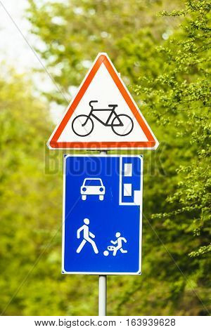 Bicycle lane sign against green Bicycle, Pedestrian