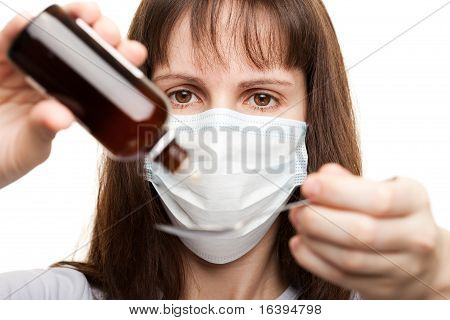 Doctor In Mask Holding Medicine Syrup