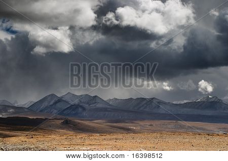 Landscape with mountains and storm clouds