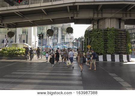 BANGKOK THAILAND - DEC 31 : unidentified tourist walk across crosswalk near Erawan shrine at Ratchaprasong Junction while new year Festival on december 31 2016 thailand.