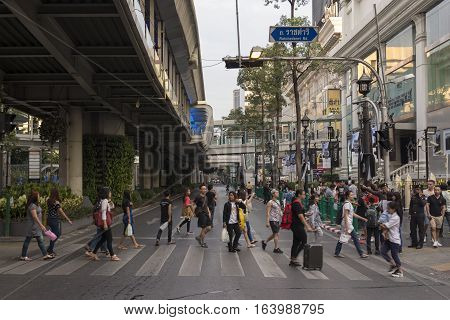 BANGKOK THAILAND - DEC 31 : scene of people walk across crosswalk in off traffic near Erawan shrine while new year Festival on december 31 2016 thailand.