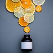 Healthy Foods And Medicine Concept. Bottle Of Vitamin C And Various Citrus Fruits. Mixed Citrus Frui poster