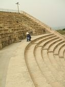 Tired Tourist/Woman Climbing Stairs Of Roman Theatre poster