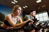 Couple In A Spinning Class Wearing Sportswear. poster