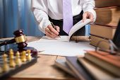 Young Lawyer Business Man Working With Paperwork On His Desk In Office Workplace, Consultant Lawyer poster