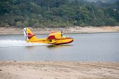 stock photo of hydroplanes  - Red and yellow hydroplane on rescue loading water - JPG