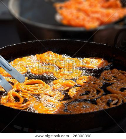 Cooking Indian sweet jalebi