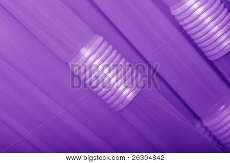 purple drinking straws, colored background