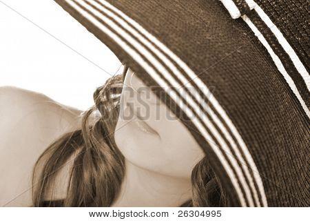 woman wearing a posh hat