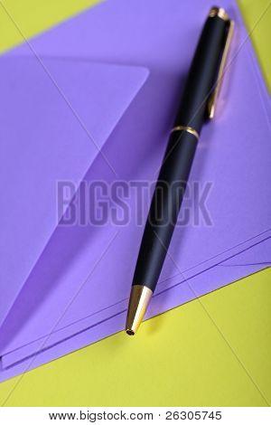 purple envelope,letter and pen