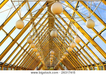 yellow construct with spheres and blue sky