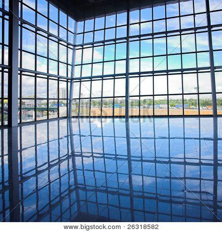 Empty corner in office centre, glass windows