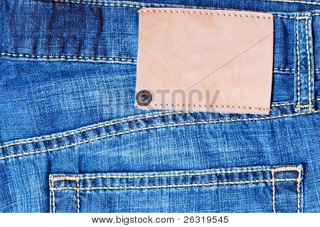 Denim background with blank label