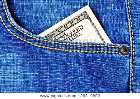 Jeans pocket with one hundred dollars banknotes