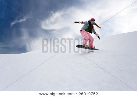 Girl rider jump on snowboard