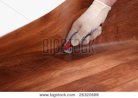 Worker cutting linoleum
