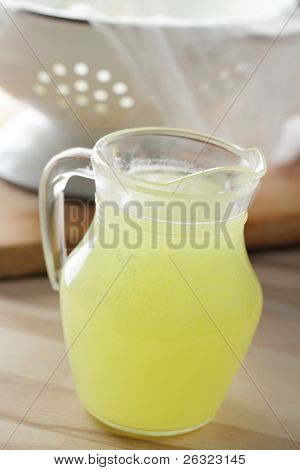 Jug with whey on the rustic table
