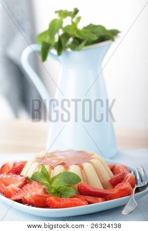 Semolina pudding with sliced strawberry, jam, and peppermint