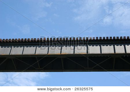 Train Tressel with bright blue sky in the background.
