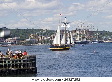 HALIFAX, NOVA SCOTIA - JULY 20: Liana's Ransom, a  topsail schooner, sails past the crowds bordering Halifax Harbour during the sailpast of the Nova Scotia Tall Ships Festival 2009 on July 20, 2009 in Halifax.