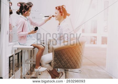 poster of Little Girl With Curlers. Beautiful Little Lady. Girl In Beauty Salon. Child Does Makeup. Consept Be