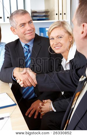 Business people make a deal, handshake