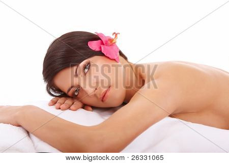 Attractive young woman relaxing in spa, beauty, wellness salon or in bed